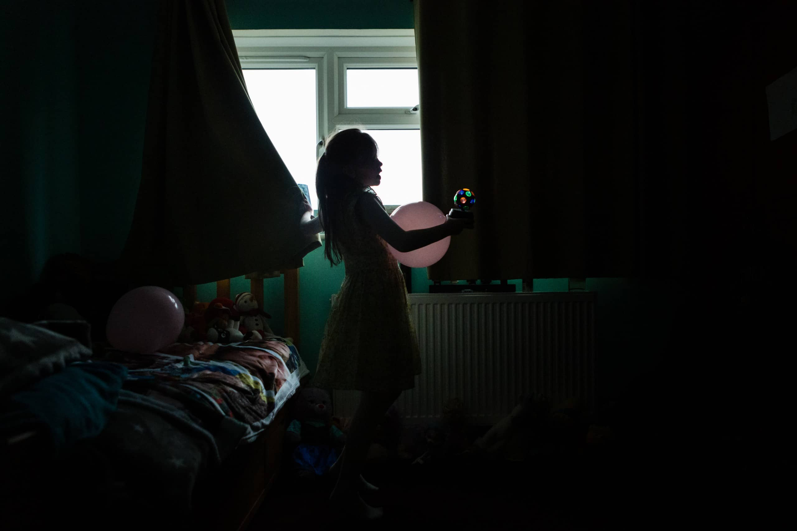 holding a toy coloured light