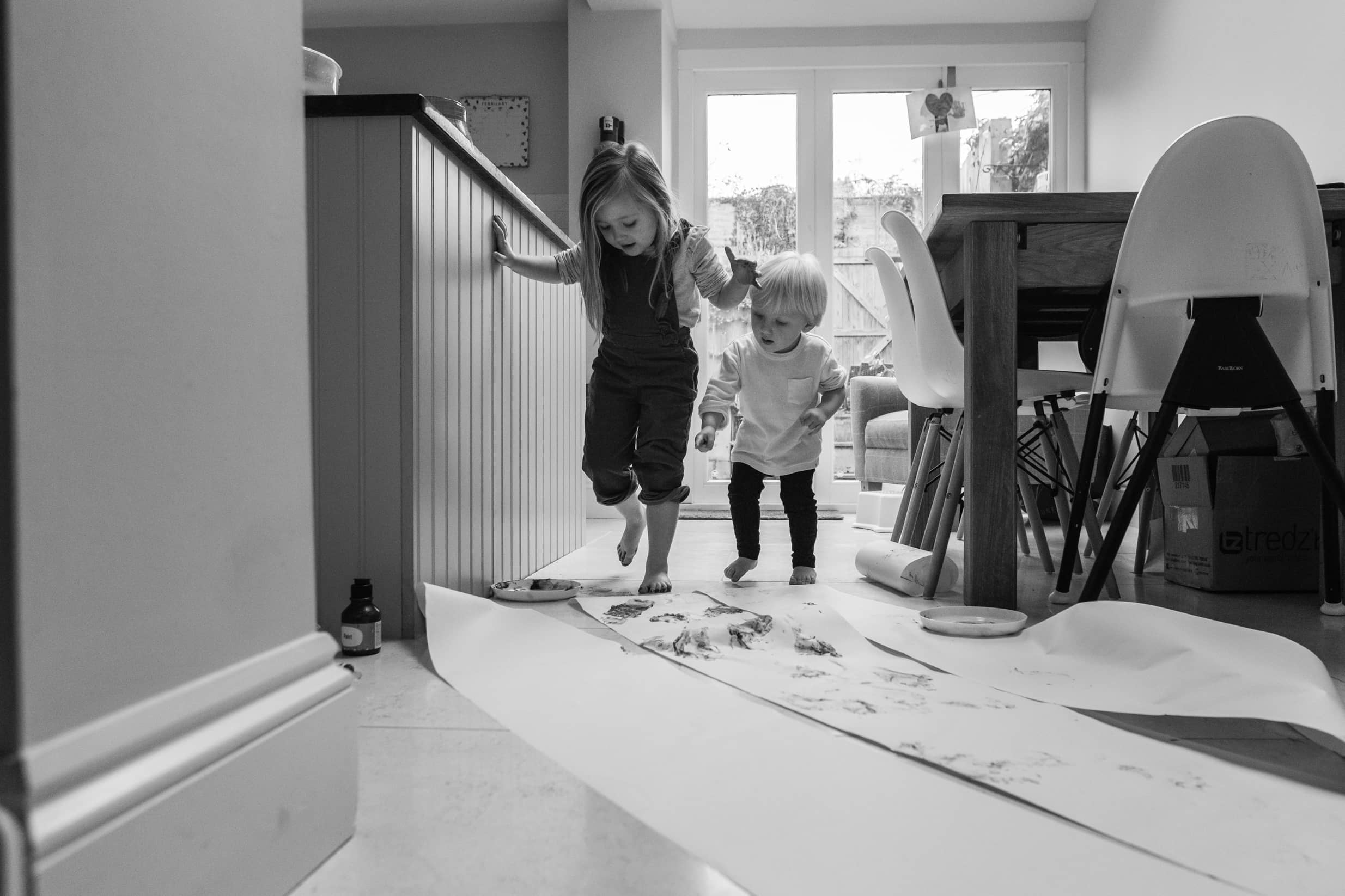 Young siblings paint with their feet | Documentary Family Photography Bath Bristol