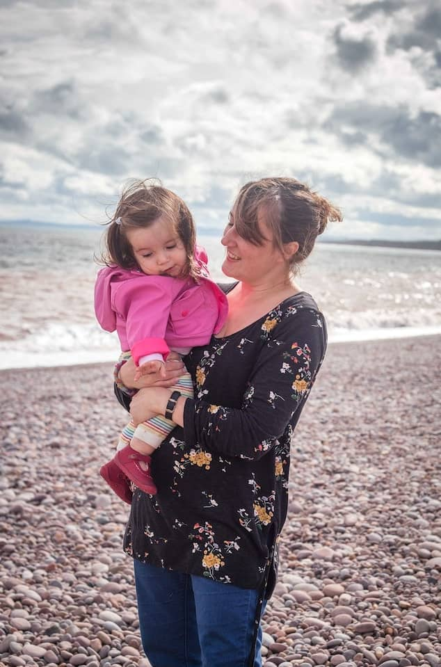 Rose Dedman holding her young daughter | Family Photographer Bath