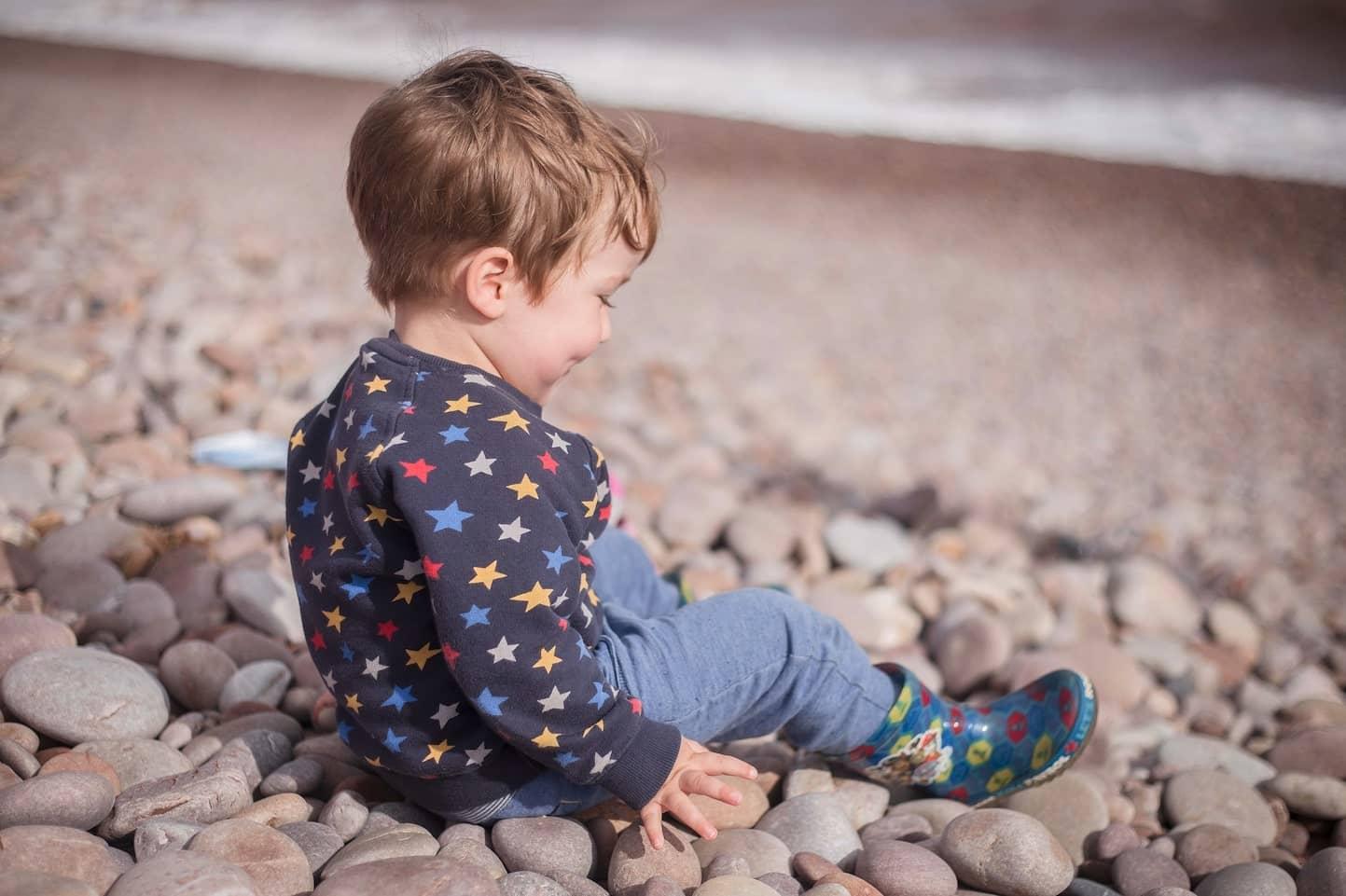 boy sat on the rocks