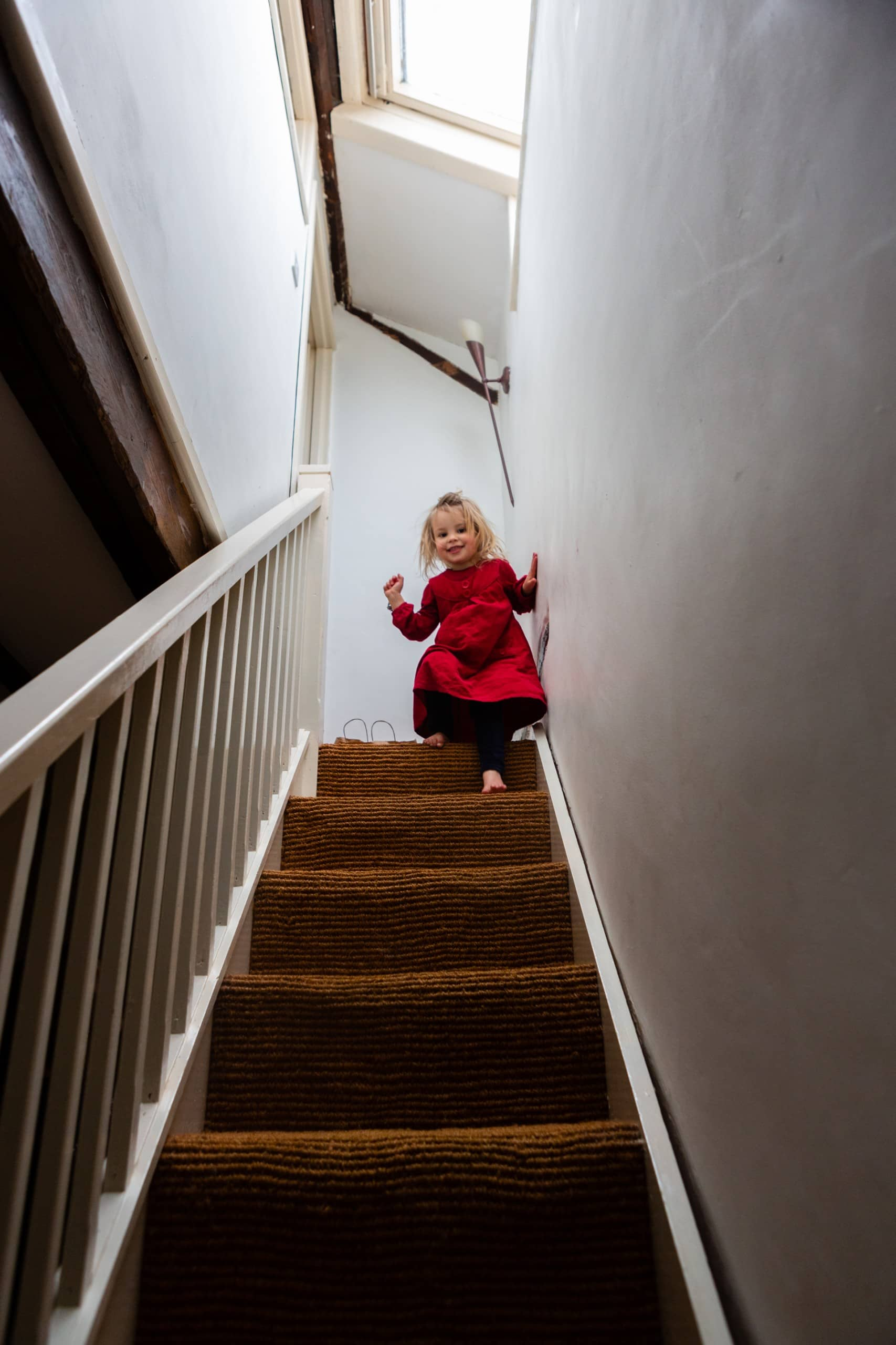 Little girl walks down the stairs