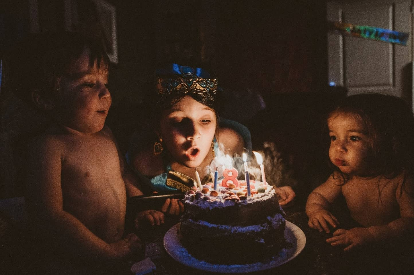 3 children blowing out birthday candles | Special occasion photographer Bath