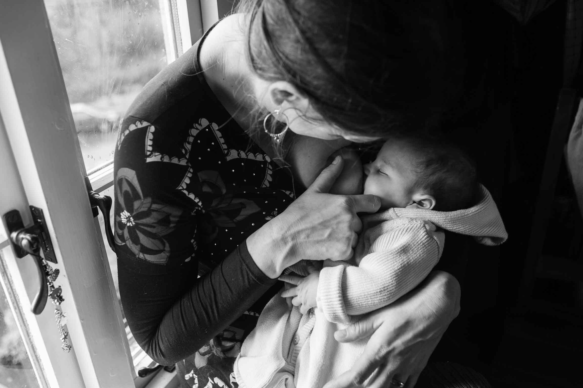 Baby feeding from mother | Somerset Family Photography