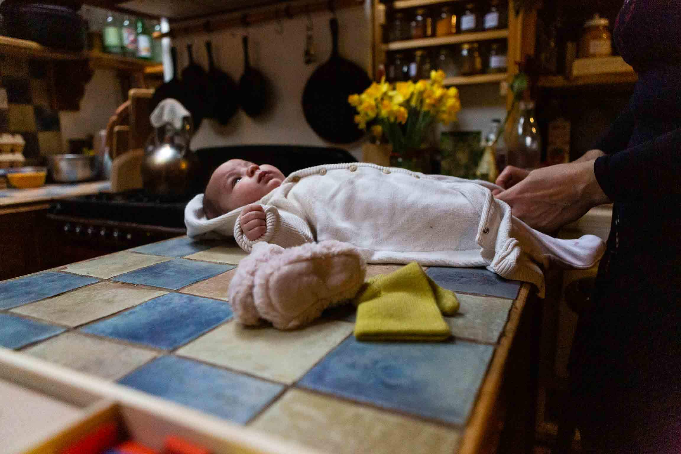 Baby being changed on the countertop | Somerset Family Photography