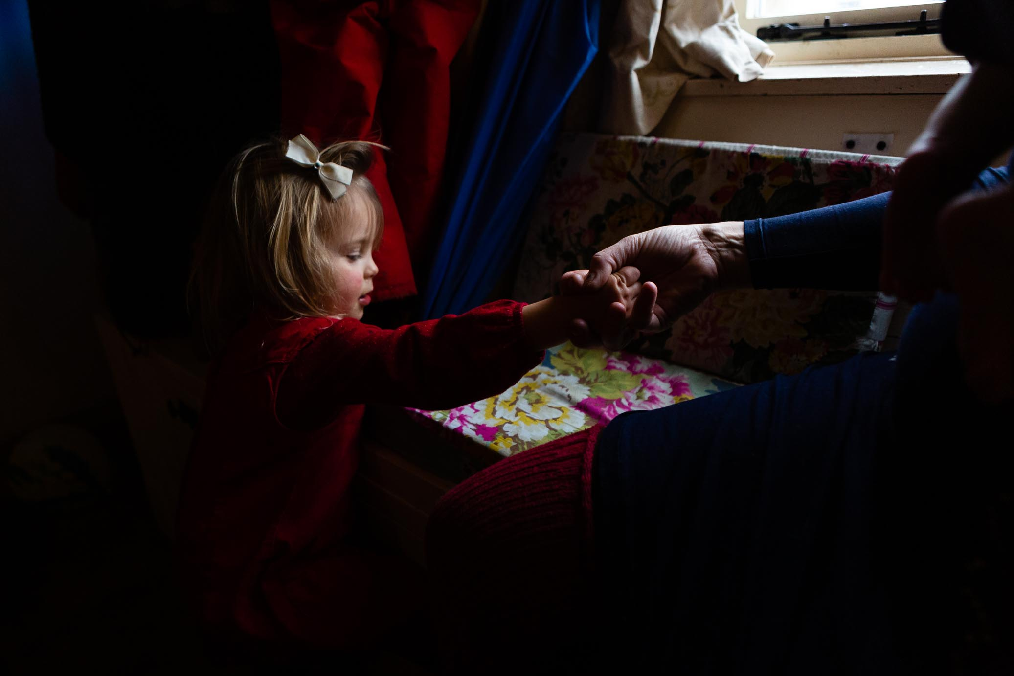 Little girl having a helping hand from mother | Somerset Family Photography