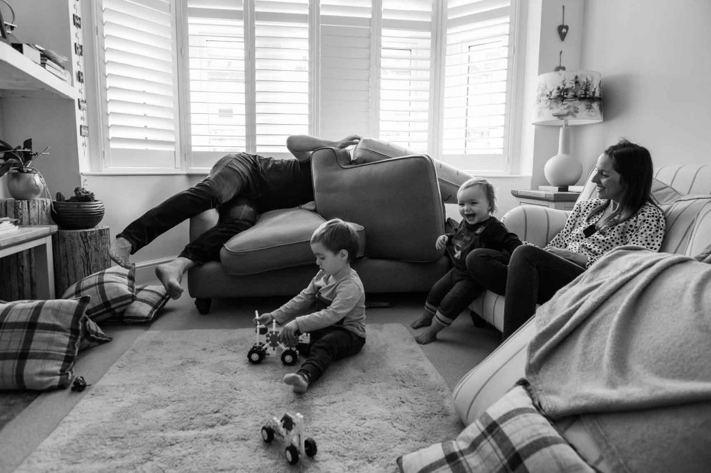 Family messing about in their living room
