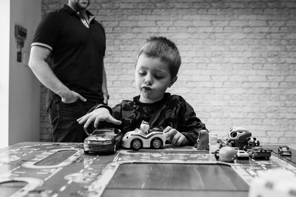 Young boy playing with cars
