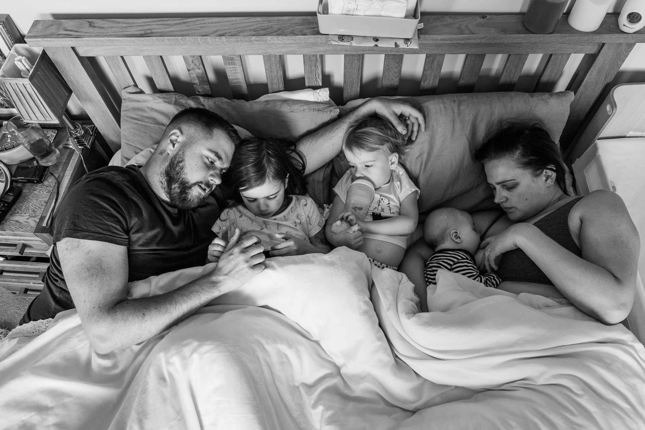 Family of five in bed having Sunday snuggles | Bath Family Photography