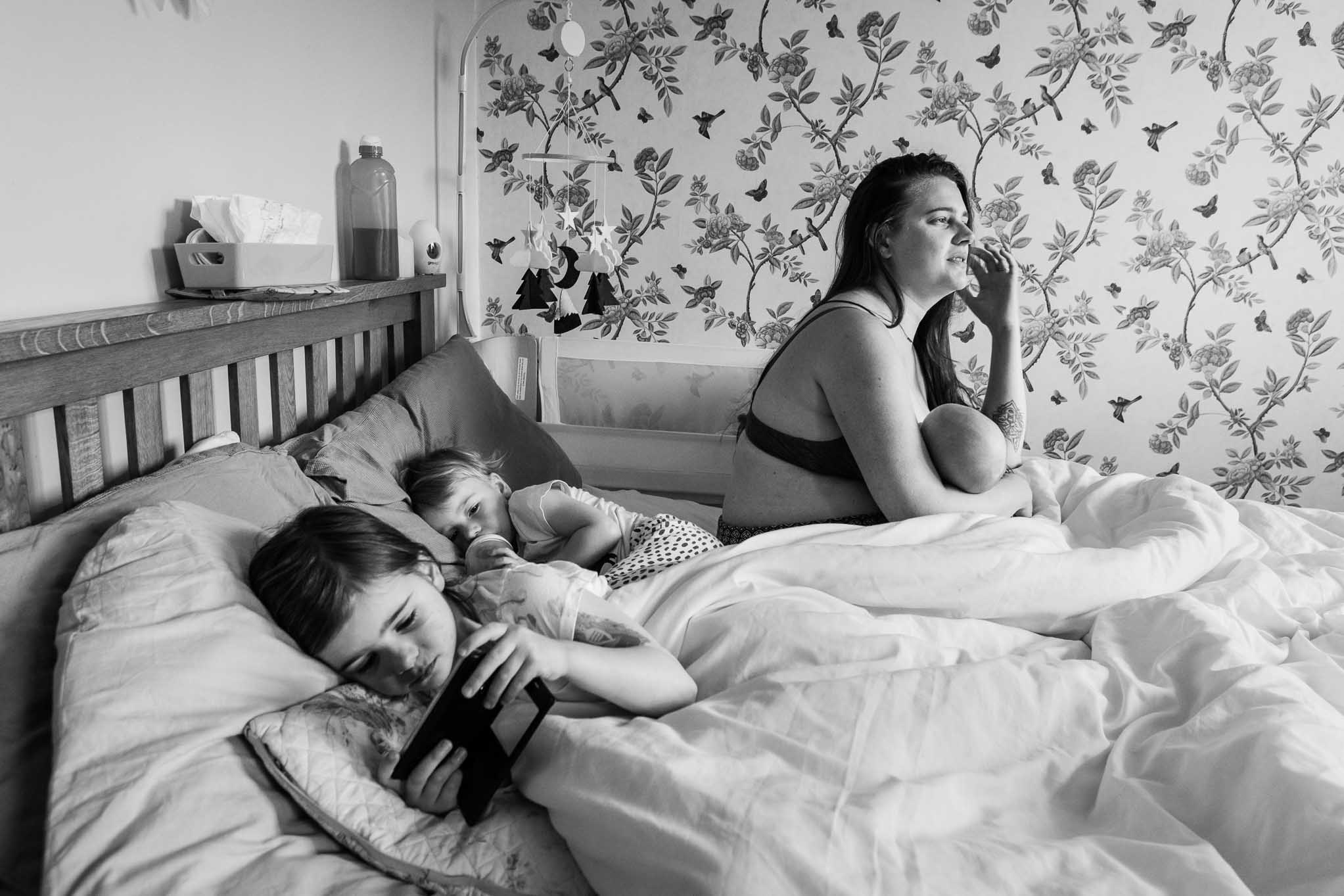 Mother, two daughter and a baby in bed | Bath Family Photography