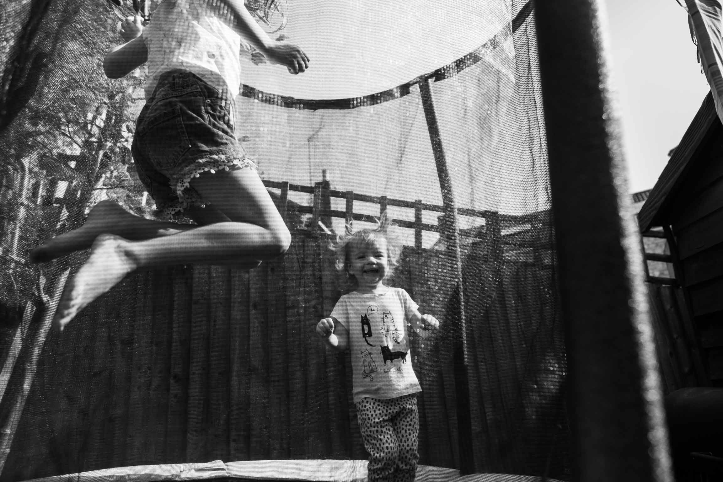 Two sisters jumping on trampoline | Bath Family Photography