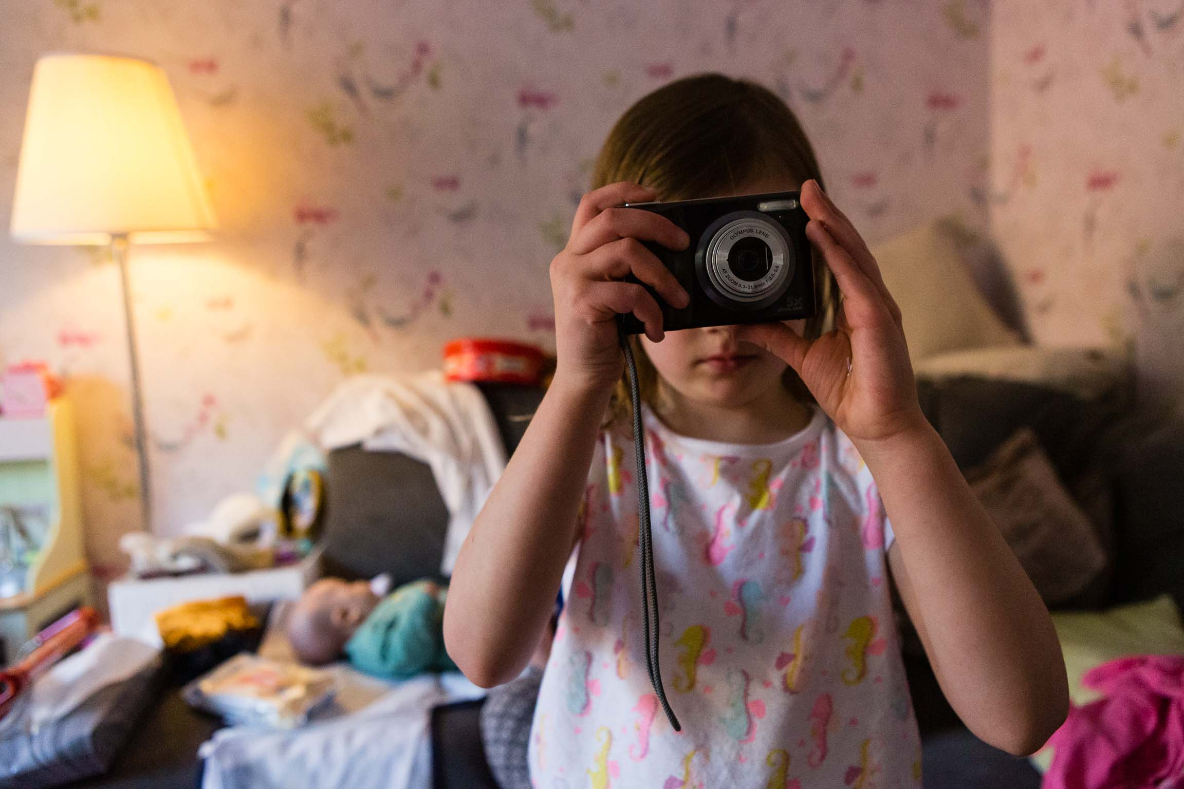 Little girl photographing the photographer | Bath Family Photography